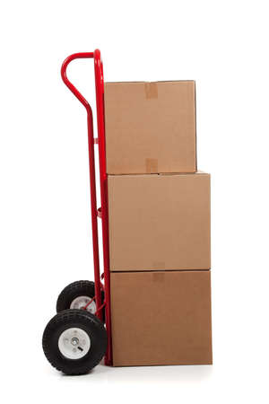 hand truck: Brown cardboard moving box on a white background with a fragile sticker
