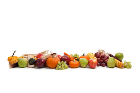 An arrangement of fall fruits and vegetables photo