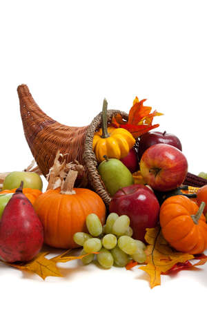 A Fall arrangement in a cornucopia on a white background photo