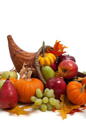 A Fall arrangement in a cornucopia on a white background Stock Photo