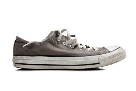 converse: A pair of grey sneakers on white