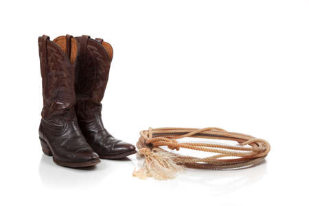 Brown leather cowboy boots on a white background photo