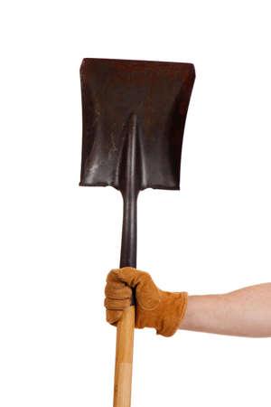 A gloved hand holding a shovel with a white background Reklamní fotografie