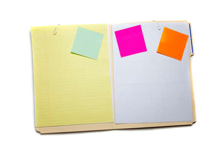 A manilla folder with postit notes on white background photo