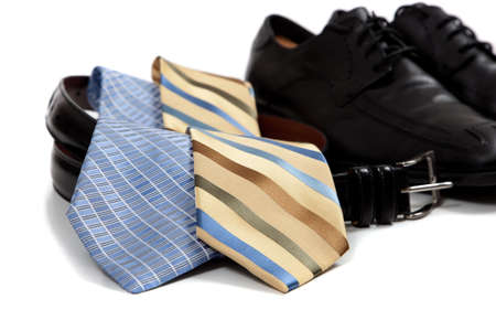 assorted mens clothing accessories including shoes, ties, belt Imagens