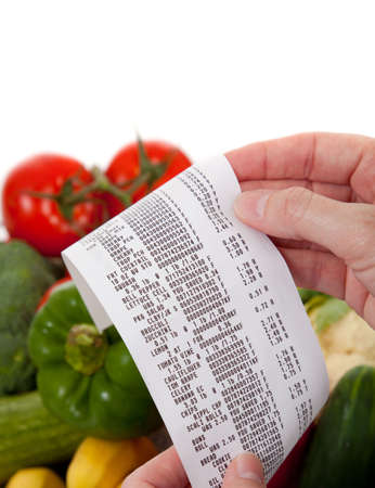 A Receipt over bag full of vegetables photo