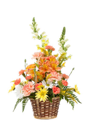 Flower arrangement including carnations irises daisy greenery in a wicker basket on a white background photo