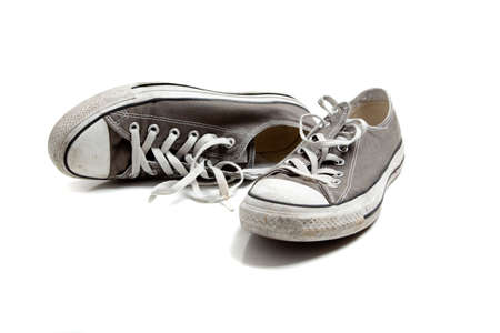 A pair of grey sneakers on white photo
