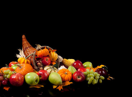 fall arrangement of fruits and vegetables in a cornucopia on a black background Stock Photo - 5723572