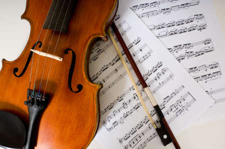 violins: A violin and bow laing on sheet music Stock Photo