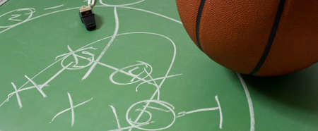 Basetball and chalkboard with a play written on it photo