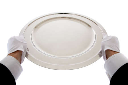 silver tray: A waiter with wihte gloves  holding a sterling silver tray on a white background