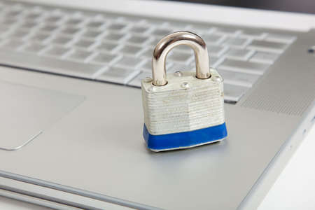 A silver padlock on a laptop computer Stock Photo - 5736230