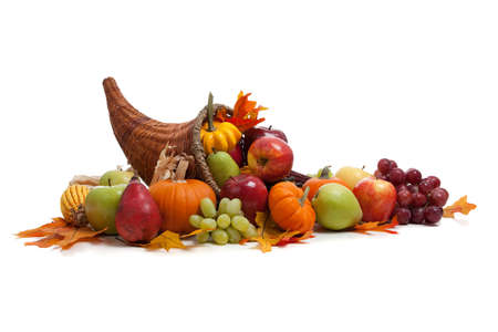 gourds: A Fall arrangement in a cornucopia on a white background Stock Photo