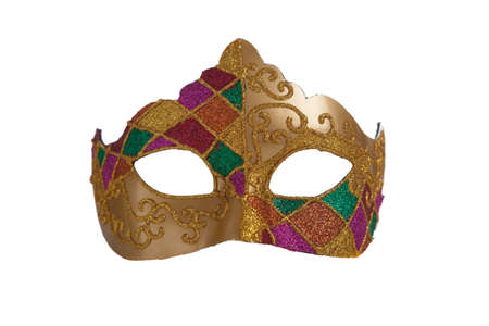 A gold mardi gra mask with green and purple beads on a white background photo