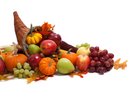 A Fall arrangement in a cornucopia on a white background Imagens