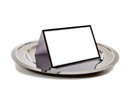silver tray: Blank white notebook lined in black on a silver tray on a white background