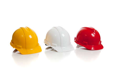 A yellow, white and red hard hat on a white background photo