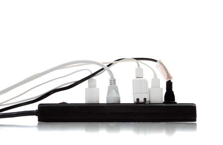 surge: An over loaded surge protector Stock Photo