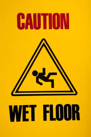 mopped: yellow Caution wet floor sign Stock Photo