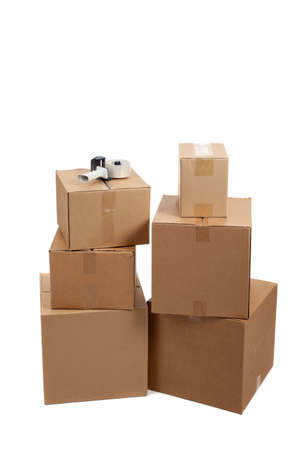 packer: Several moving boxes and a tape gun on a white background Stock Photo