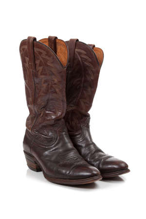 Brown leather cowboy boots on a white background 版權商用圖片