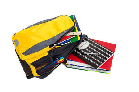Yellow and black backpack with school supplies inculding composition books, notebooks, folders and text books on a white background Stock Photo - 5766119
