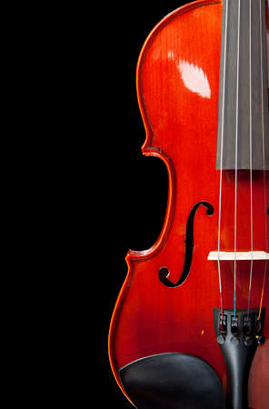 A Partial ciew of a violin on a black background photo
