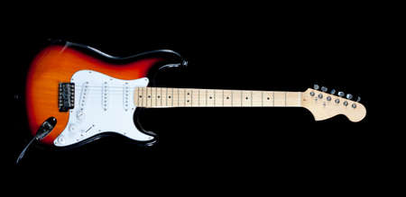An electric guitar on a white background