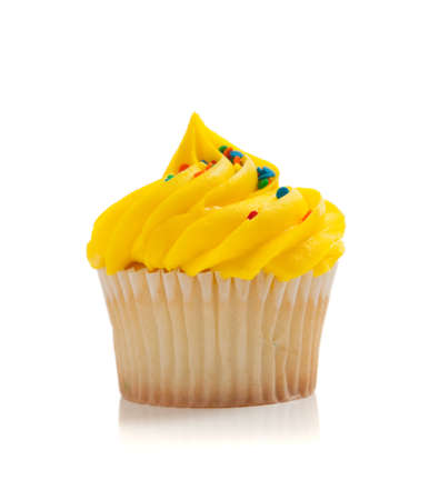 yellow: Yellow Cupcake with colored sprinkles on a white background Stock Photo