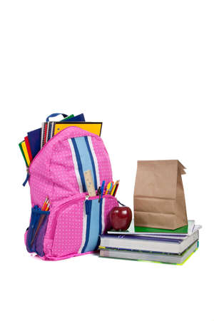 back packs: Pink and blue backpack with school supplies, textbooks, an apple and a sack lunch Stock Photo