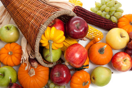 A Fall arrangement in a cornucopia on a white background Stock Photo - 5766173