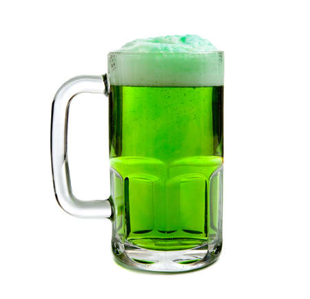 A beer mug of green beer with a foamy head on a white background - St. Patricks Day themd