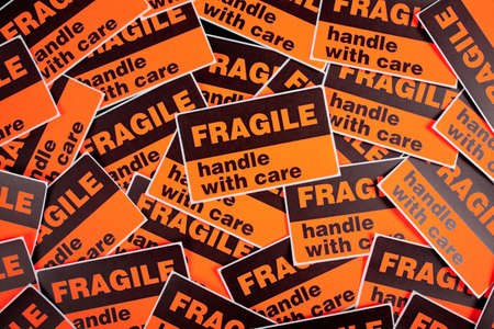A background of orange fragile stickers