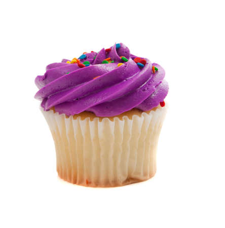 Purple Cupcake with colored sprinkles on a white background Фото со стока
