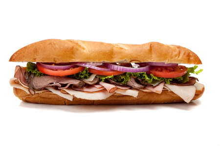 turkey bacon: A submarine sandwich including ham, turkey, roast beef, tomato, lettuce, onion and cheese on a french bun on a white background