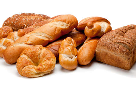 Assorted breads including croissants, french bread, whole grain on a white background photo
