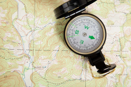 topographical: Compass laying on a topographical map