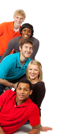 A group of happy multi-racial college students on a white background Stock Photo