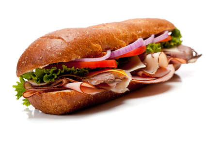 A sumarine sandwich with ham, turkey, roast beef, bacon, lettuce, tomato, cheese and onion on a white background photo