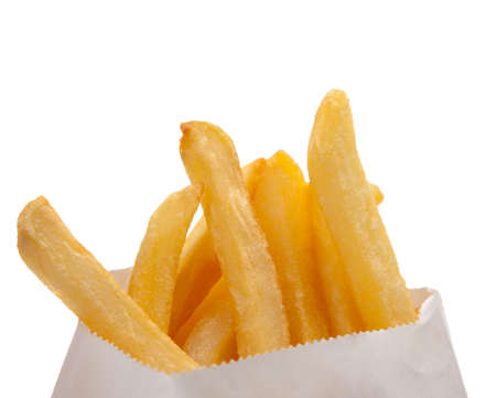 Golden French fries in a white bag on a white background Stok Fotoğraf