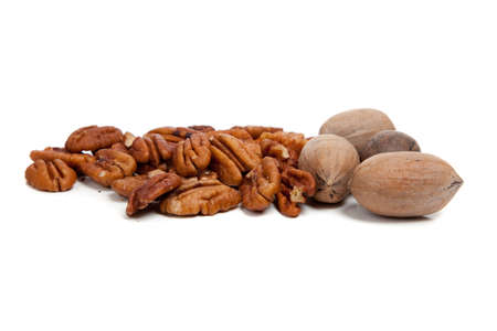 whole pecans: whole and shelled pecans on a white background