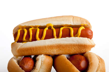 wiener dog: Hot dogs on a bun with mustard on a white background Stock Photo