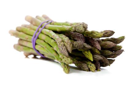 A bundle of asparagus on a white background Banco de Imagens