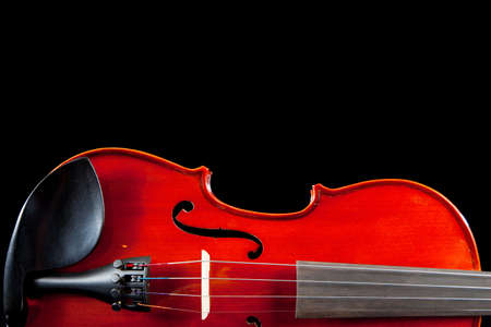 concerto: a partial view of a violin on a black background