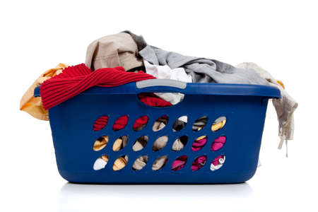 A blue laundry basket full of dirty clothes with laundry soap on a white background Stock Photo - 5850844