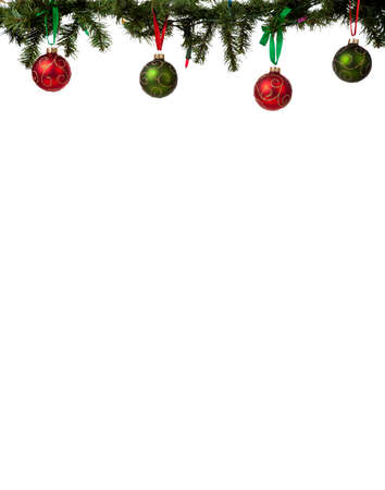 A christmas ornament border with red and green glittered baubles hanging from garland with red and green ribbon 免版税图像