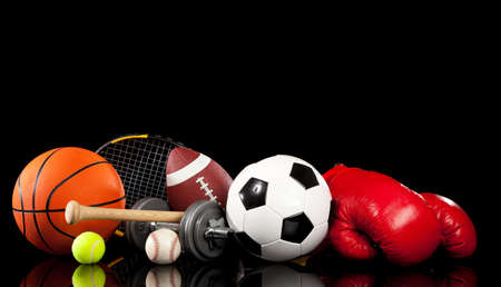 Assorted sports equipment included a basketball, american football, soccer ball, baseball, tennis ball, boxing gloves, tennis racket, baseball bat and dumbbells