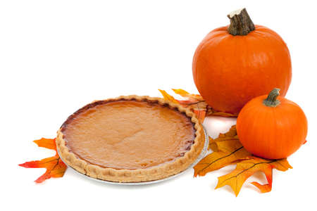 A pumpkin pie with pumpkins and fall leaves on a white background Stock Photo - 5850911