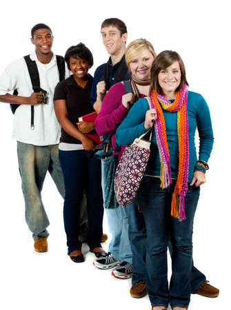 A group of happy multi-racial college students holding backpacks on a white background Stock Photo